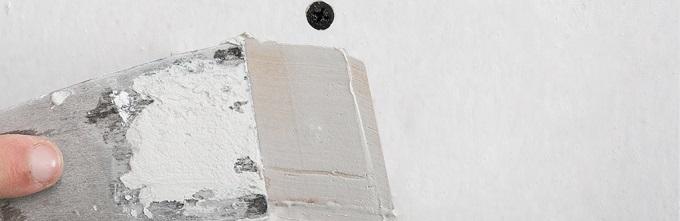 buchi muro stucco stuccare
