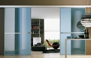 Porte scorrevoli in vetro for Porte per dividere ambienti